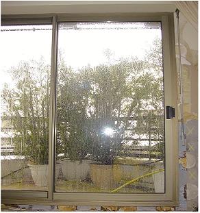 Test étanchéité baie vitrée Par rampe d'arrosage